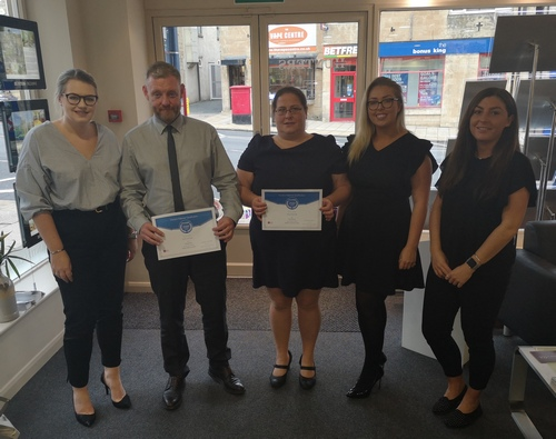 A photo of the Hunters Wetherby Team with their certificated after being fully accredited at the Hunters Training Academy.